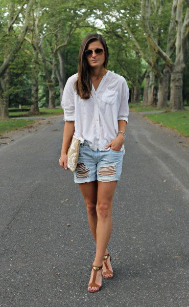 white oversized linen shirt with ripped denim shorts