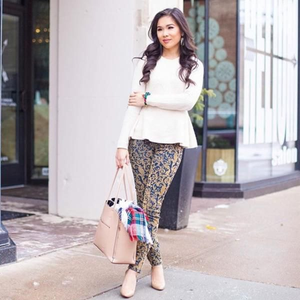 white peplum knit sweater with pink and blue tribal printed skinny pants