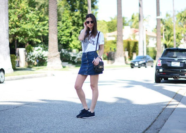 white print tee with high waisted blue button down mini skirt