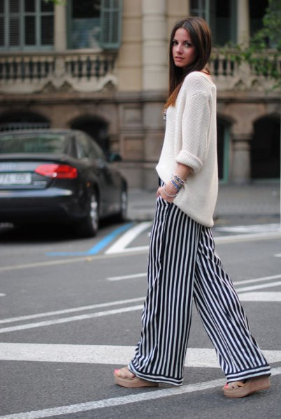white relaxed fit knit sweater with striped pants