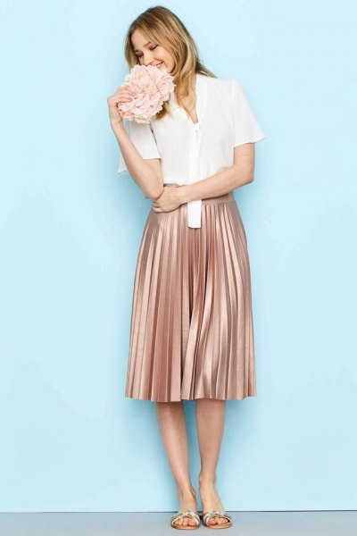 white short sleeve shirt with rose gold pleated midi skirt