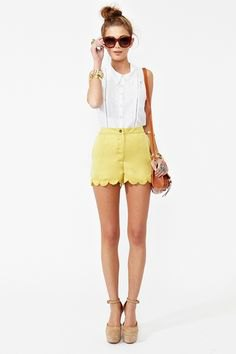 white sleeveless blouse with yellow scalloped hem mini shorts