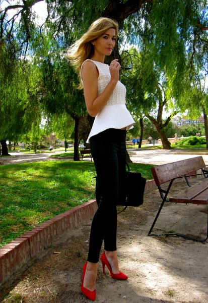 white sleeveless blouse wth black skinny chinos