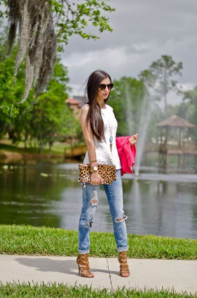white sleeveless top with boho long necklace and leopard print clutch bag