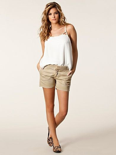 white spaghetti strap vest top with beige chino shorts
