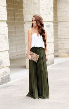 white sweetheart neckline top with green maxi pleated skirt