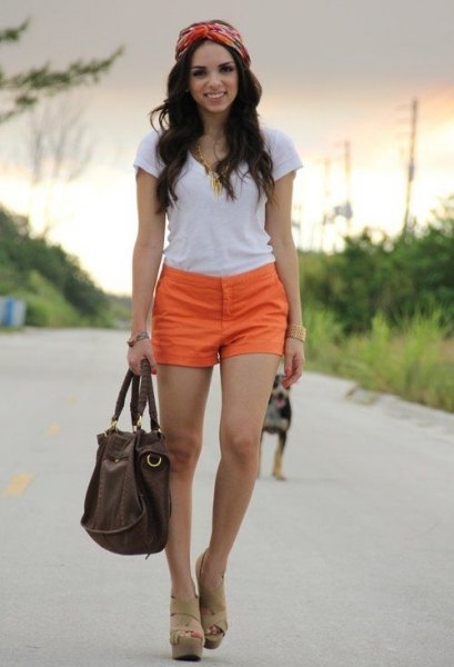 white tee with orange shorts and nude heeled sandals