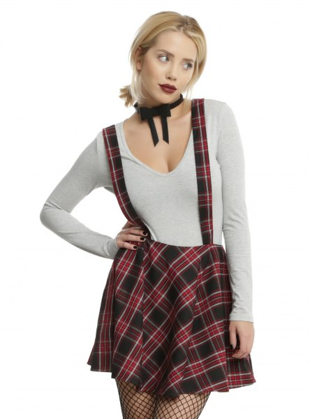white v neck long sleeve t shirt with green plaid suspender dress