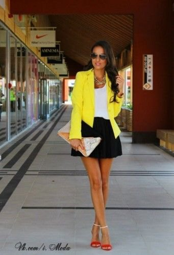 yellow blazer with white tank and black mini skater skirt