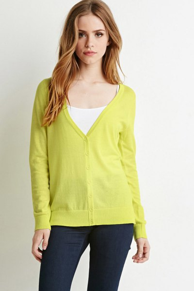 yellow v neck cardigan with white vest top
