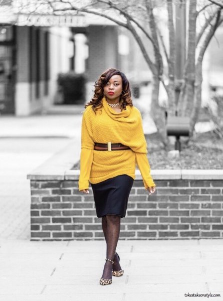 belted half sleeve sweater over long sleeve yellow tee