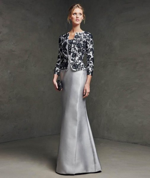 black and white floral lace form fitting evening jacket with silver silk dress