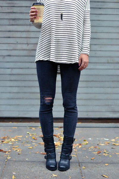 black and white striped long sleeve tee with dark blue ripped moto jeans