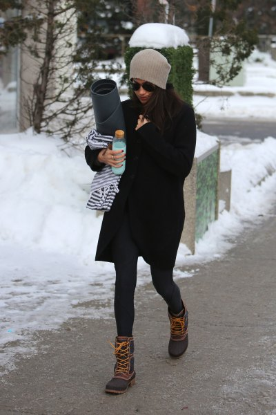 black coat dress with stockings and lace up snow boots