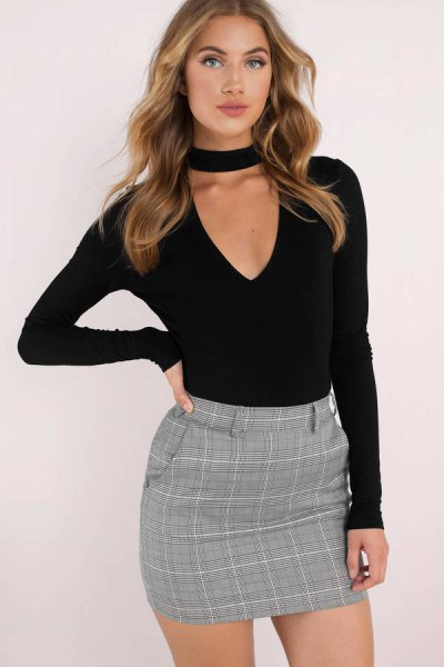 black cut out deep v neck form fitting long sleeve top with tweed pencil skirt