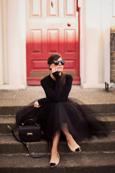 black form fitting sweater with maxi tutu dress