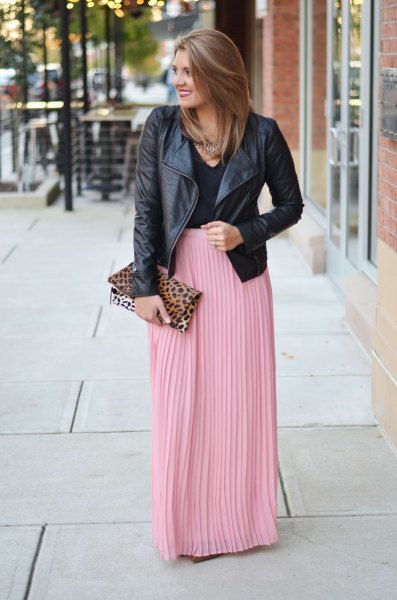 black leather jacket with pink pleated maxi skirt