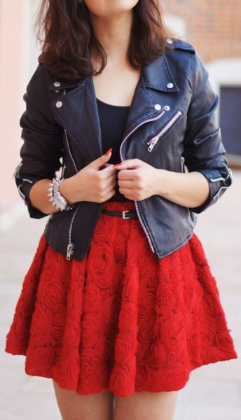 black leather jacket with red belted rose embroidered skater skirt