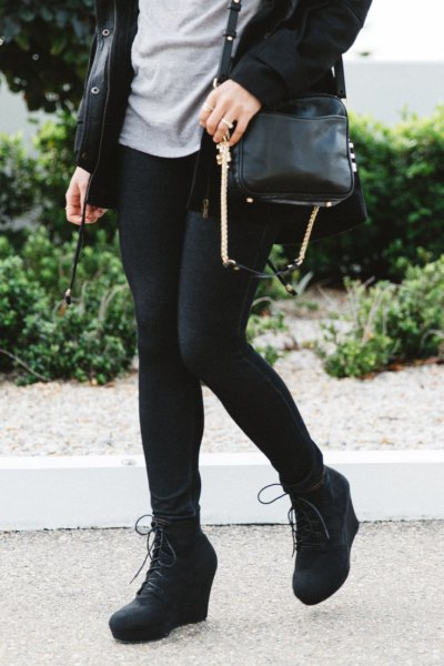 black long trench coat with leggings and wedge booties