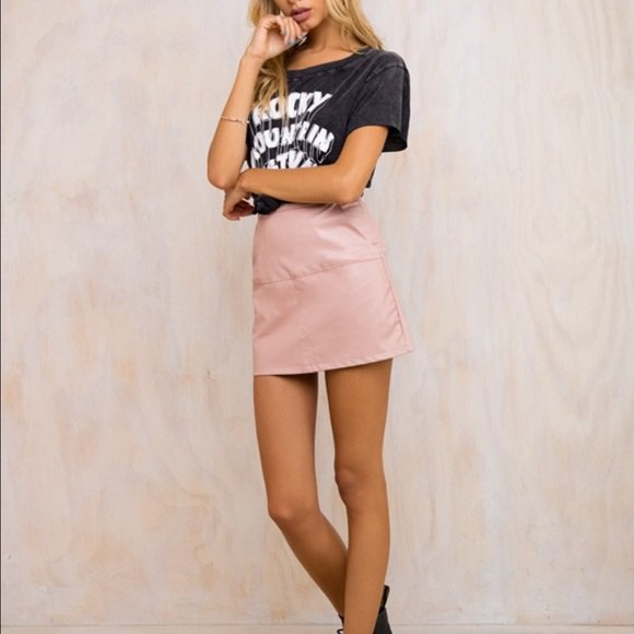 black print tee with high waisted mini pink leather skirt