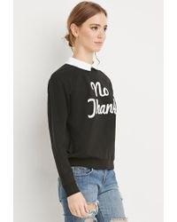 black printed sweatshirt with blue ripped skinny jeans