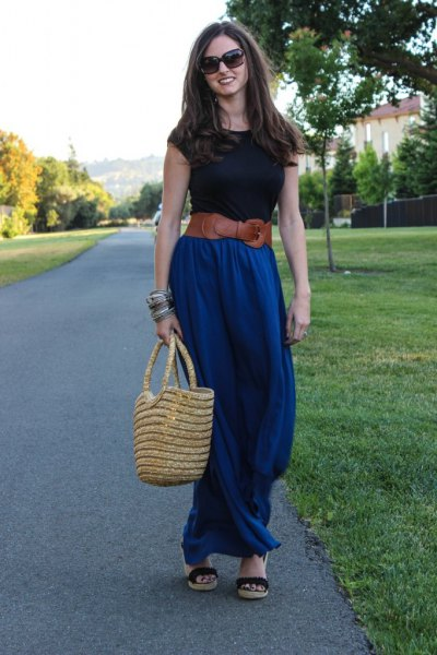 black t shirt with brown belt and blue maxi skirt