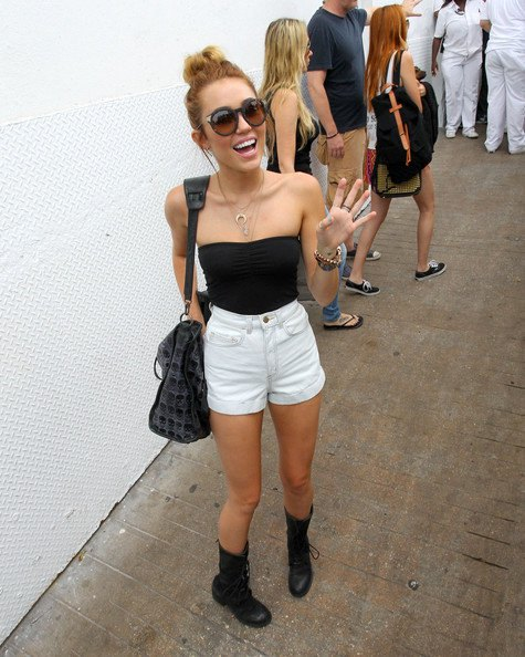 black tube top with white high waisted mini shorts