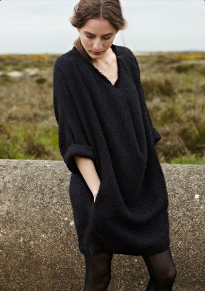 black v neck wide sleeve sweater dress with stockings