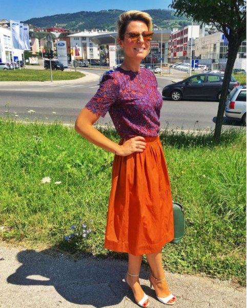 blue printed short sleeve blouse with orange midi flared skirt