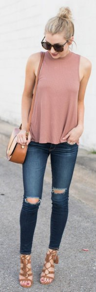 blush pink mock neck tank top with dark blue ripped jeans