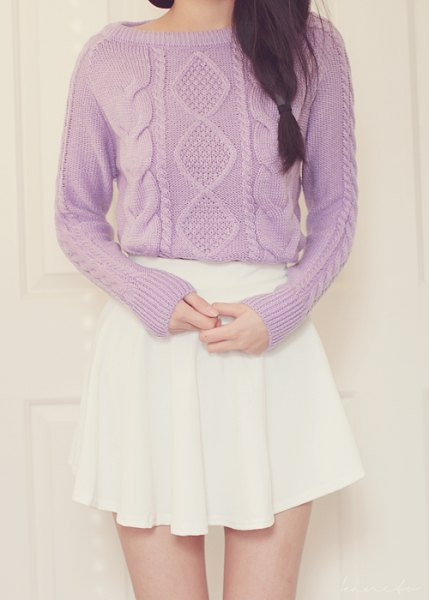 boat neck cable knit sweater with white mini pleated skirt
