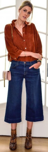 brown button up suede shirt with blue flared cropped jeans