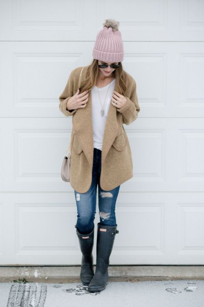 camel coat with white tee and ripped jeans