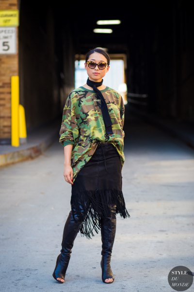 camo oversized sweater with black leather open toe knee high boots