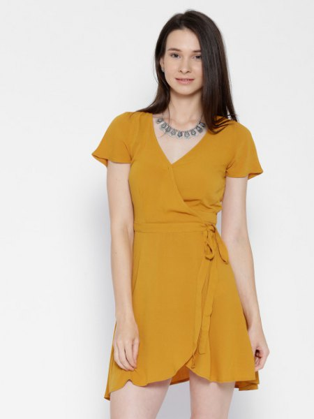 cap sleeve mini chiffon wrap dress with statement necklace