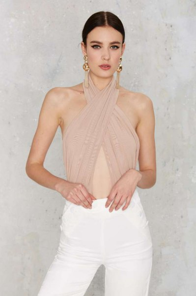 criss cross halter neck blush pink bodysuit blouse with white jeans