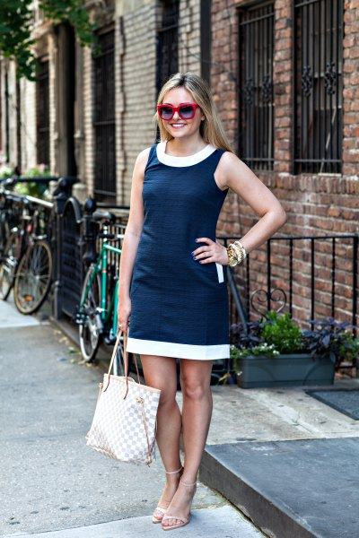 dark blue mini tank dress with white neckline and hem