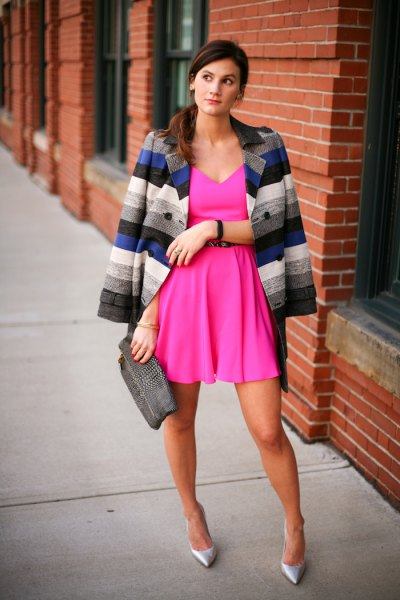deep v neck pink dress with multi colored striped blazer