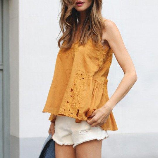 gold lace sleeveless blouse with white mini shorts