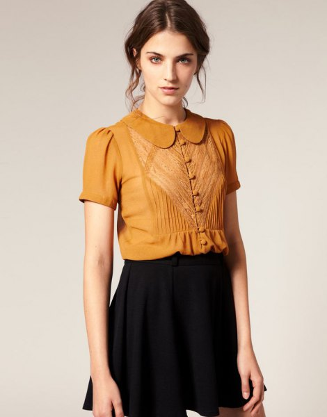 golden short sleeve round collar button up blouse with black mini skirt