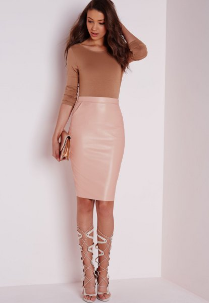 green form fitting sweater with high waisted pale pink leather knee length skirt