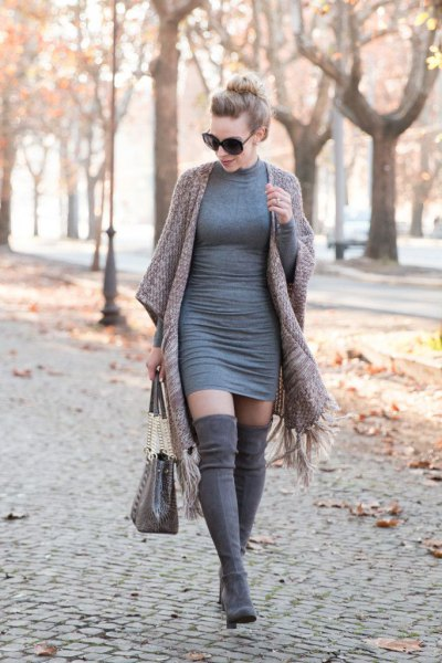 grey form fitting sweater dress with matching fringe cape