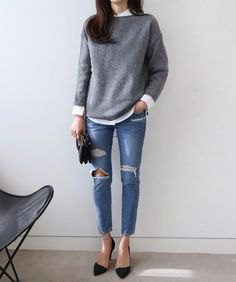 grey knit sweater with white button up shirt and ripped skinny jeans