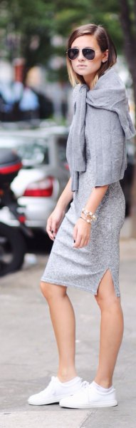 grey lace midi dress with sweater draped over shoulders