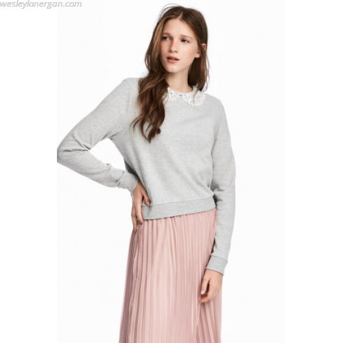 grey sweatshirt with pale pink pleated midi skirt