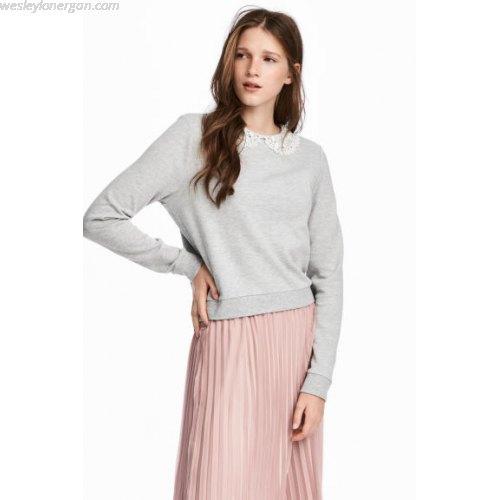 grey sweatshirt with pale pink pleated midi skirt
