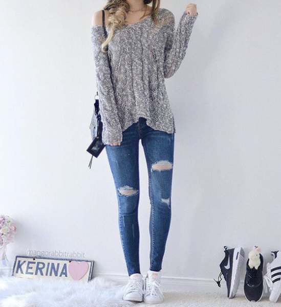 heather grey one shoulder knit sweater with blue ripped skinny jeans