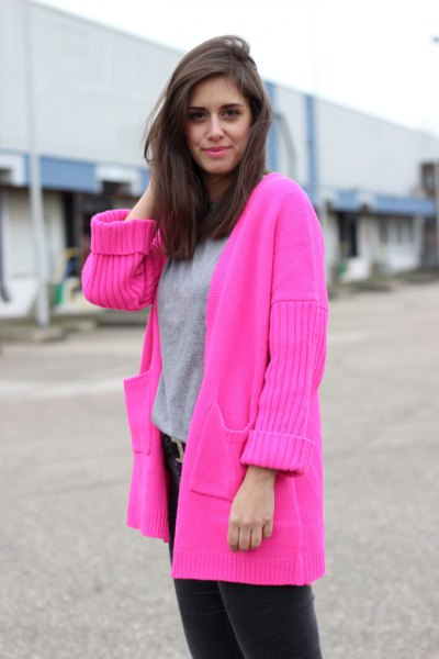 hot pink sweater cardigan with grey sweatshirt and black jeans