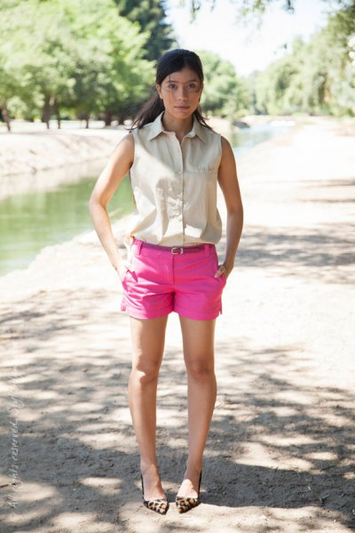 ivory sleeveless button up shirt with hot pink mini shorts