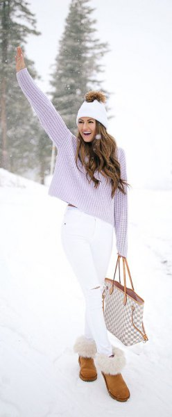 lavender ripped knit sweater with white skinny jeans